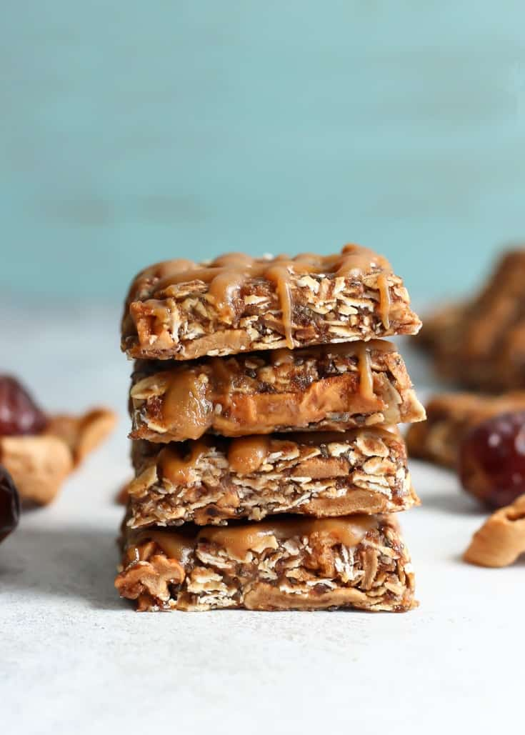 Easy, no-bake, vegan and gluten free Medjool Date Spiced Apple Oat Bars. No added sugars! This snack bar is packed with whole grains, healthy fats, fiber, and sweetened with fruit.