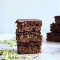 healthy flourless brownies in stack with spiralized zucchini