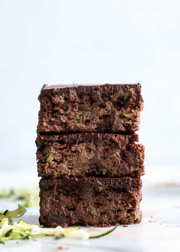 These Paleo and flourless Zucchini Brownies are a must on your summer baking list! Topped with an almond butter chocolate ganache – you can't say no!