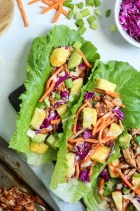 Paleo and Whole30 Pineapple BBQ Pork Lettuce Wraps! A healthy dinner, great meal prep too! Can't go wrong with lettuce wraps!
