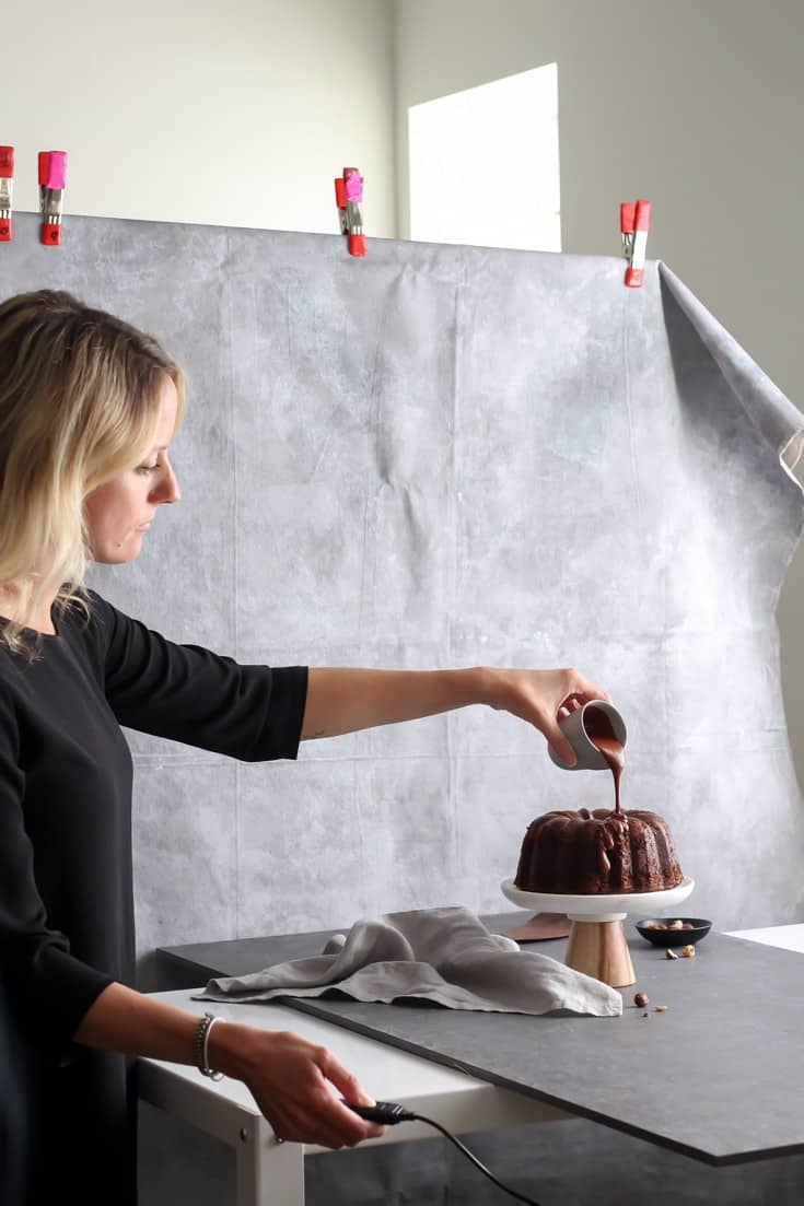 Sophie Bourdon of The Green Life setting up her pour shot for a chocolate bundt cake.