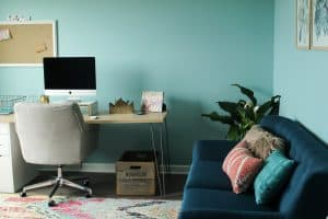 Love my new home office space! Grey oak laminate flooring plus a colorful rug really makes the room pop.
