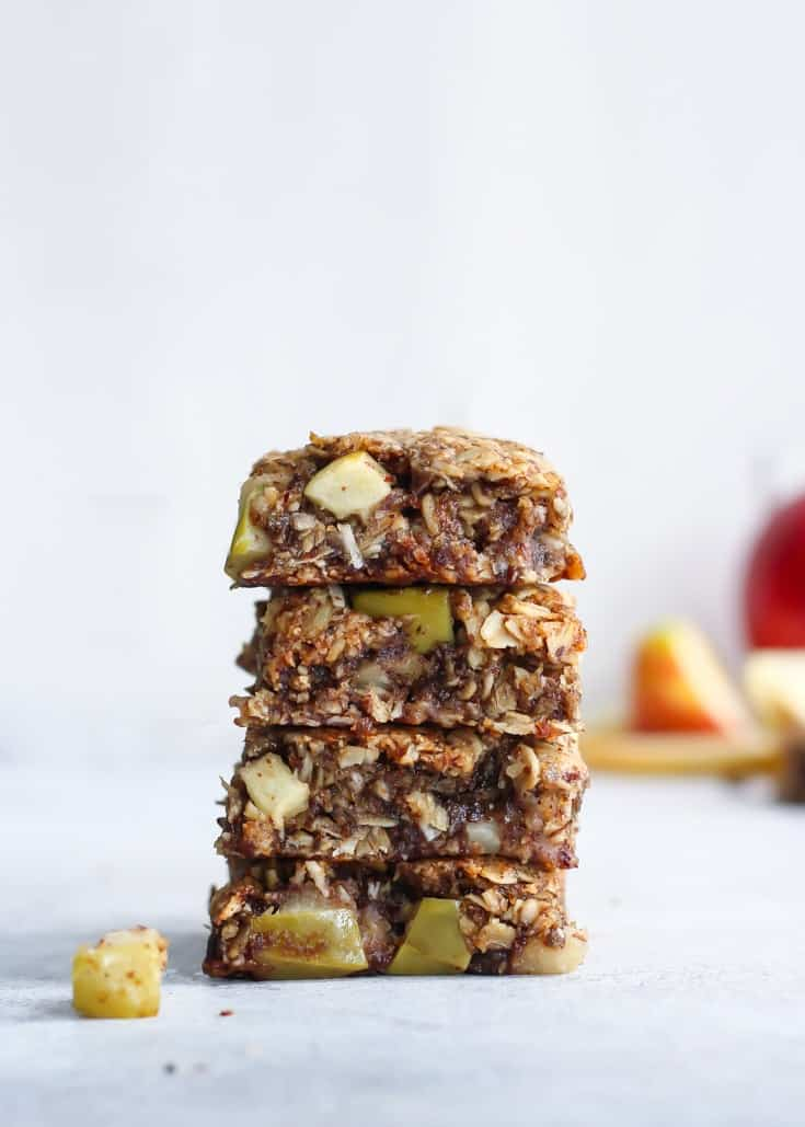 These Apple Cinnamon Oatmeal Cookie Bars are the perfect fall treat. Made vegan and gluten-free, bursting with apples and cinnamon.