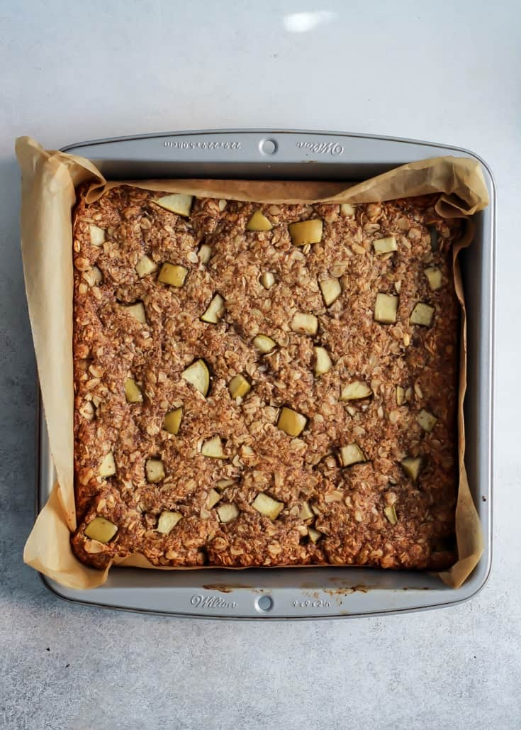 These Apple Cinnamon Oatmeal Cookie Bars come together in no time! The hardest part is waiting for them to cool! Vegan and gluten-free.