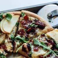 Change up your pizza routine and make this Medjool Date Apple Bacon Pizza with fontina cheese and arugula! This combo is truly delicious. Gluten-free friendly.