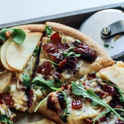 Medjool Date Apple Bacon Pizza with fontina cheese and arugula