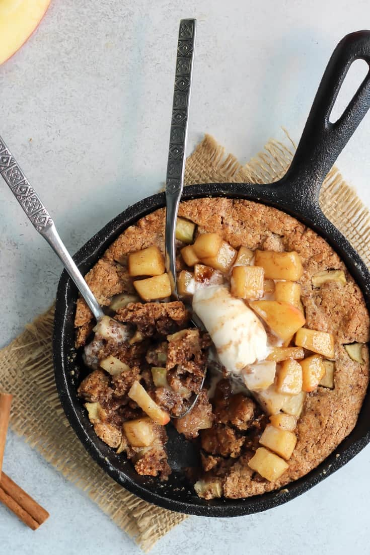 This Paleo Apple Pie Cookie Skillet is seriously so good. The best kind of dessert is the one you can eat straight from the pan it's baked in.
