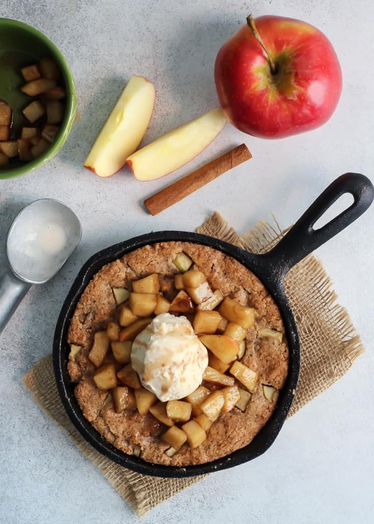 Perfect dessert for two! Paleo Apple Pie Skillet Cookie. Ready in less than 30 minutes. Topped off with warm apples, and ice cream – so good!