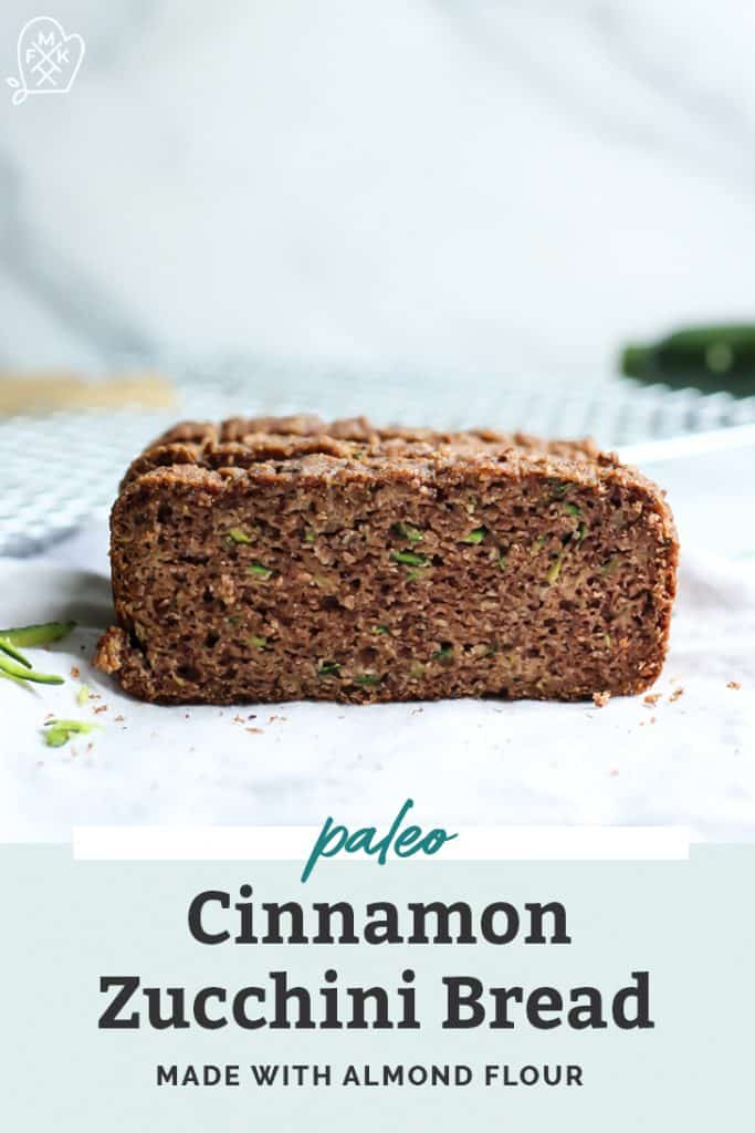 Close up image of paleo cinnamon zucchini bread loaf with text overlay