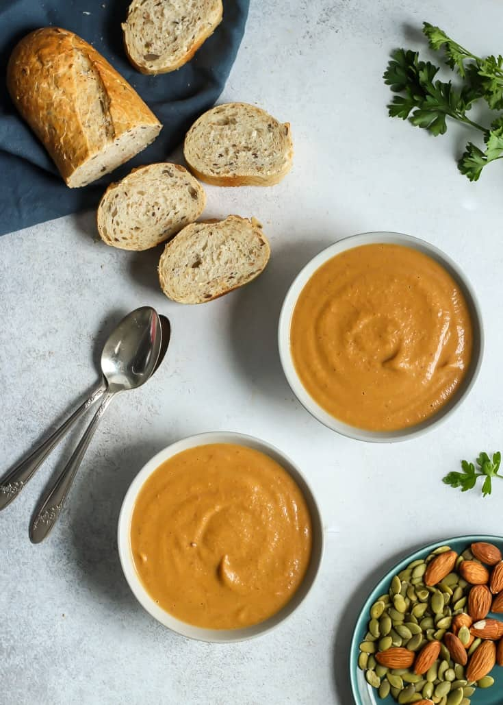 This Simple Almond Butter Pumpkin Soup is quick and easy. Vegan, gluten free, paleo and no added sugars, making it Whole30 compliant.
