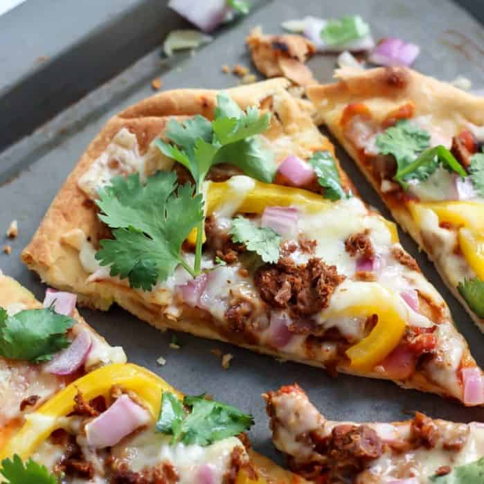 easy homemade thin crust pizza on baking sheet