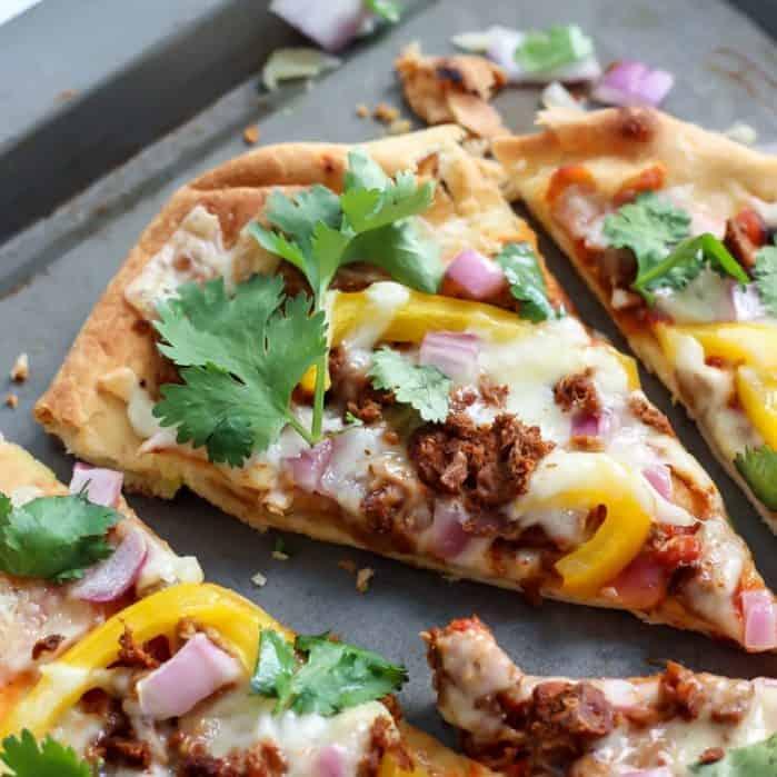 easy homemade thin crust pizza on baking sheet