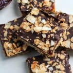 toasted coconut chocolate topped caramel oat bars