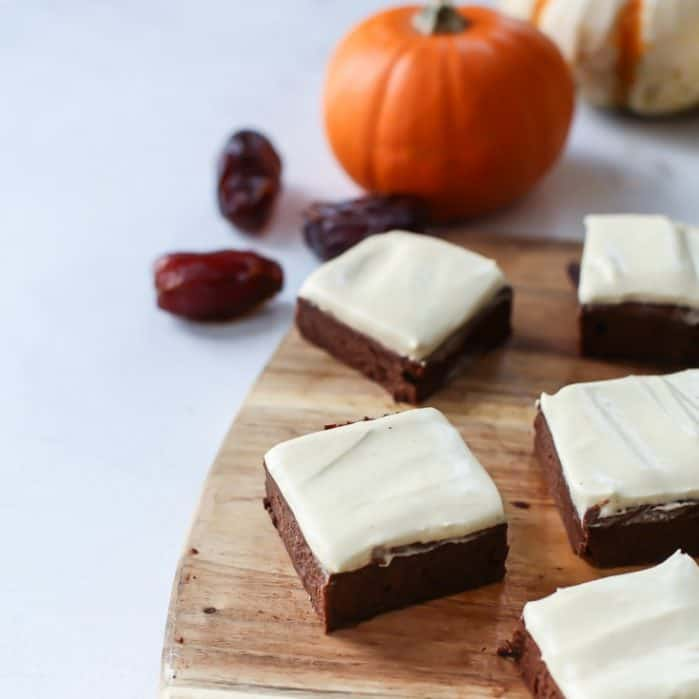 Paleo Fudgy Pumpkin Brownies with a pumpkin spice cream frosting! Vegan, grain-free and naturally sweetened with dates!