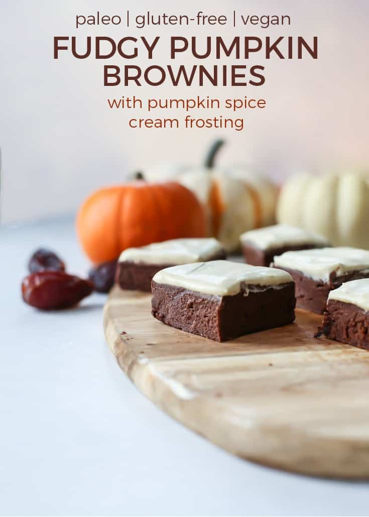 Fudgy Pumpkin Brownies with pumpkin spice cream frosting on wooden platter