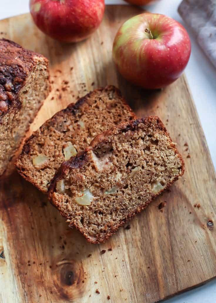 Greek Yogurt Whole Grain Apple Bread sliced on wooden tray with apples