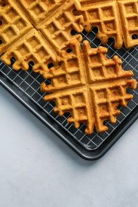 Easy Pumpkin Spice Orange Waffles. Made healthy with whole grain flour and dairy-free. Gluten-free friendly too. Make a big batch and freeze for easy mornings!