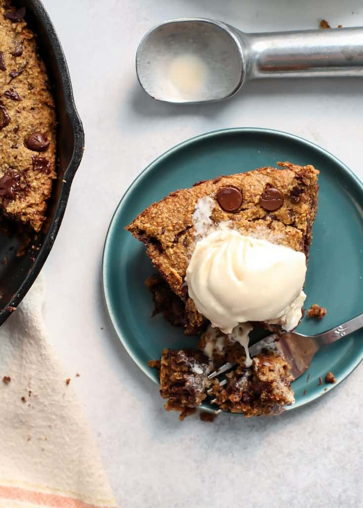 Paleo Deep Dish Chocolate Chip Pumpkin skillet Cookie on teal plate with ice cream