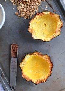 roasted acorn squash with ground cinnamon and granola