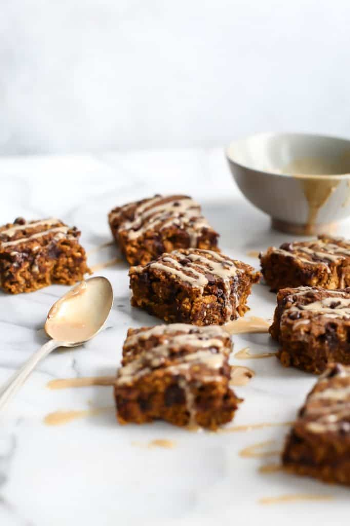 Healthy Pumpkin Oatmeal Breakfast Bars! Made vegan and with sprouted gluten-free quick oats. These bars are fall perfection.