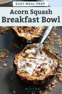 two assembled acorn squash breakfast bowls with a spoon and granola scattered