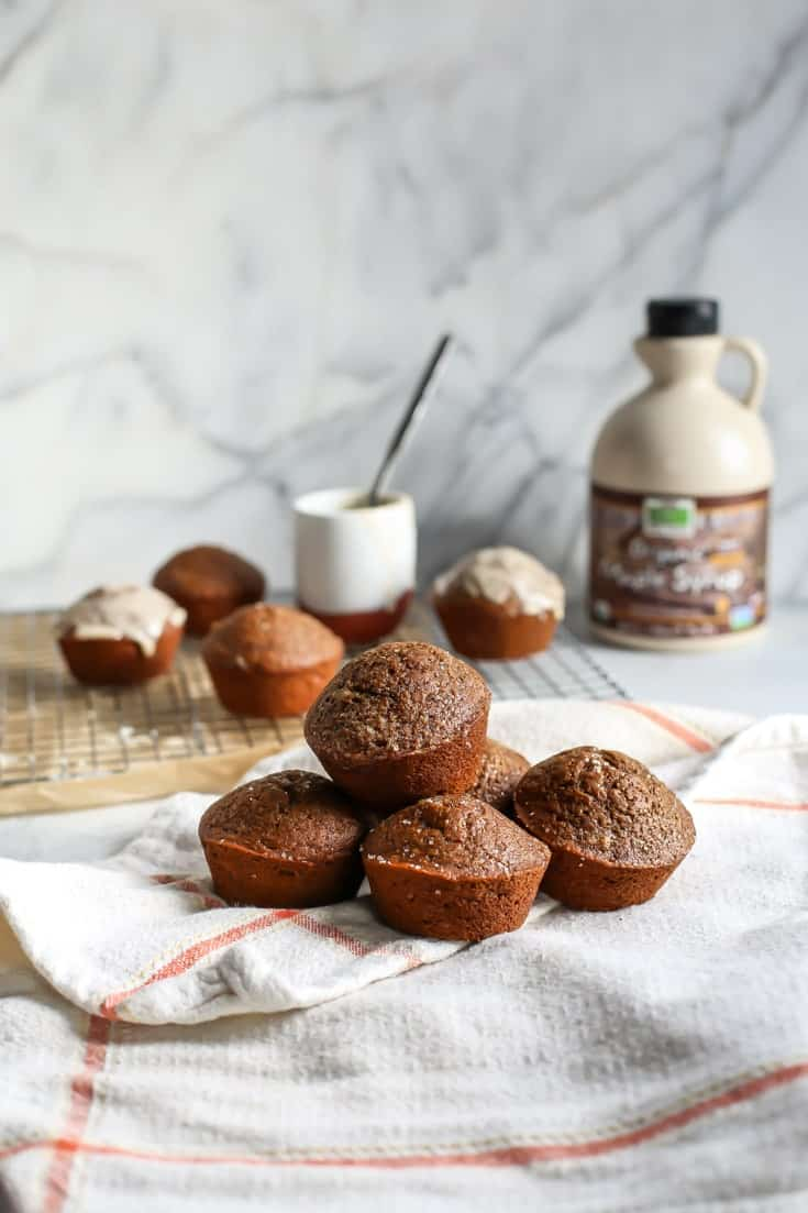 Healthy Gingerbread Muffins on towel with maple syrup