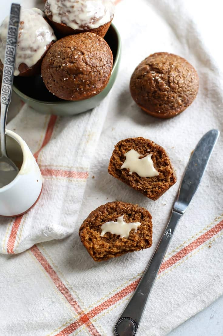 Healthy Whole Grain Vegan Gingerbread Muffins cut open with coconut butter