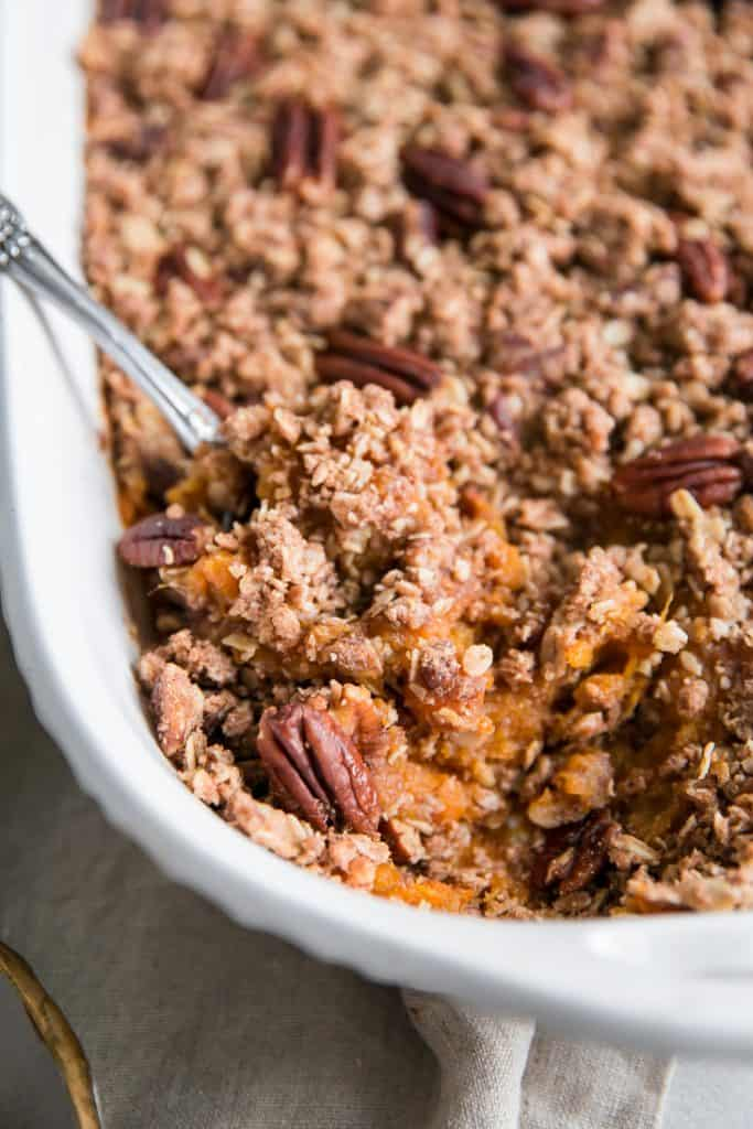 closeup of sweet potato casserole with pecans and oats