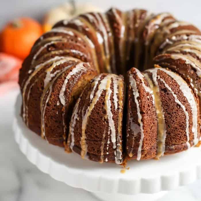 glazed pumpkin bundt cake on white cake stand