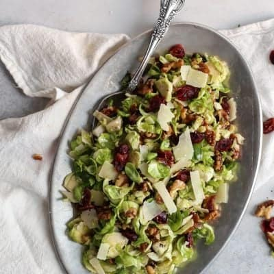 Shredded Brussels Sprouts Salad with cranberries & walnuts