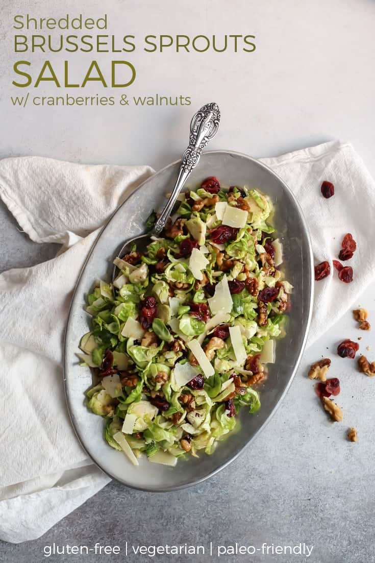 Shredded Brussels Sprouts Salad in white bowl with fork on white towel pinterest image