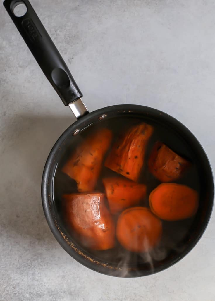 Boil sweet potatoes with skins on and they peel right off