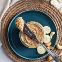 Vanilla Bean Banana Cashew Butter on knife with teal plate and rope mat