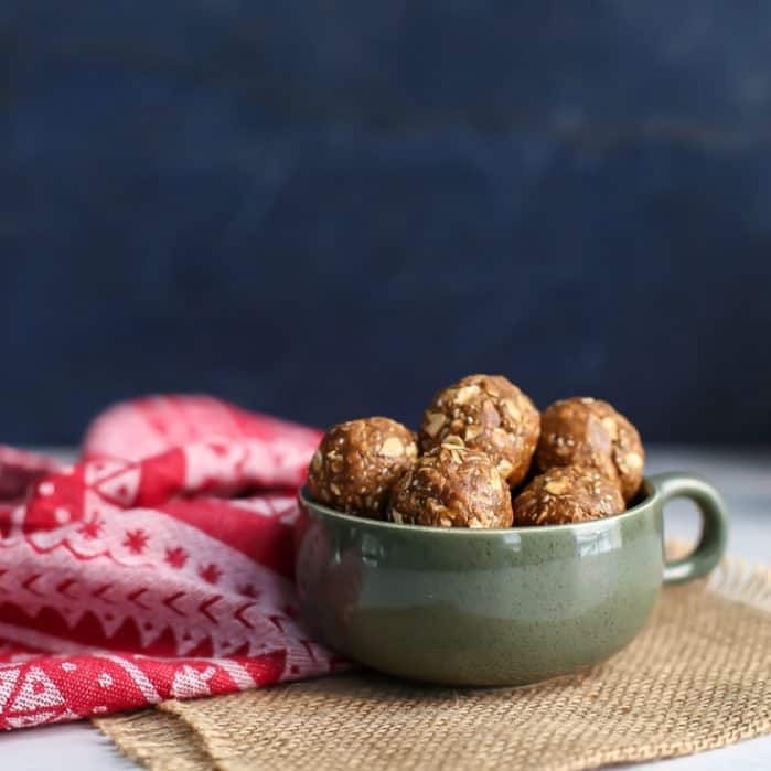 Snack time is the best time with these seasonal Gingerbread Oat Energy Balls! Made vegan and gluten-free friendly using One Degree Organic Sprouted Oats. Dip them in dairy-free chocolate for a healthier treat!
