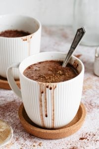 hot chocolate in white mug with spoon