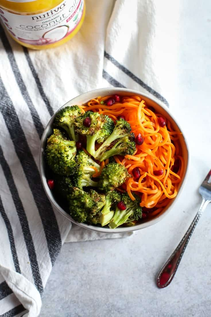 Vegan Buttery Garlic Roasted Broccoli with Sweet Potato Noodles (and pomegranate seeds!). Vegan, Paleo and Whole30 friendly. The perfect side dish for healthy eating