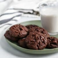 vegan double chocolate cookies on green plate