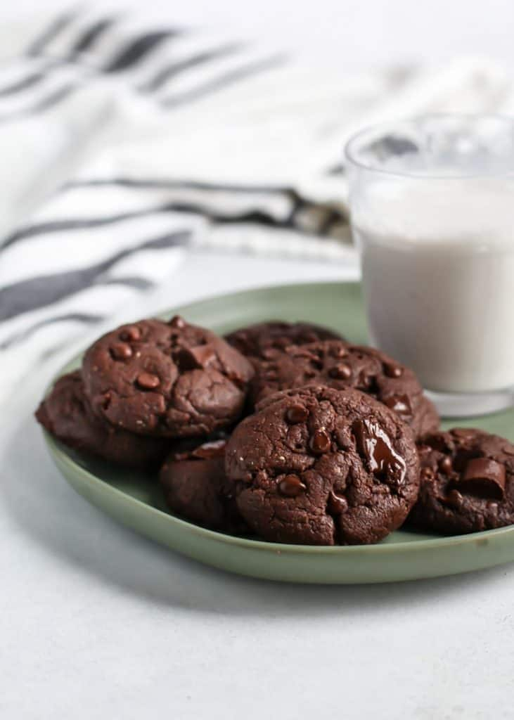 Vegan DOUBLE CHOCOLATE COOKIES. Made for the chocolate lovers out there. They happen to be made vegan using coconut oil, flaxseed and your favorite nut or seed butter. Also gluten-free friendly! Just use a 1:1 gluten-free flour or whole wheat white flour works too. Soft pillows of chocolate, right here!