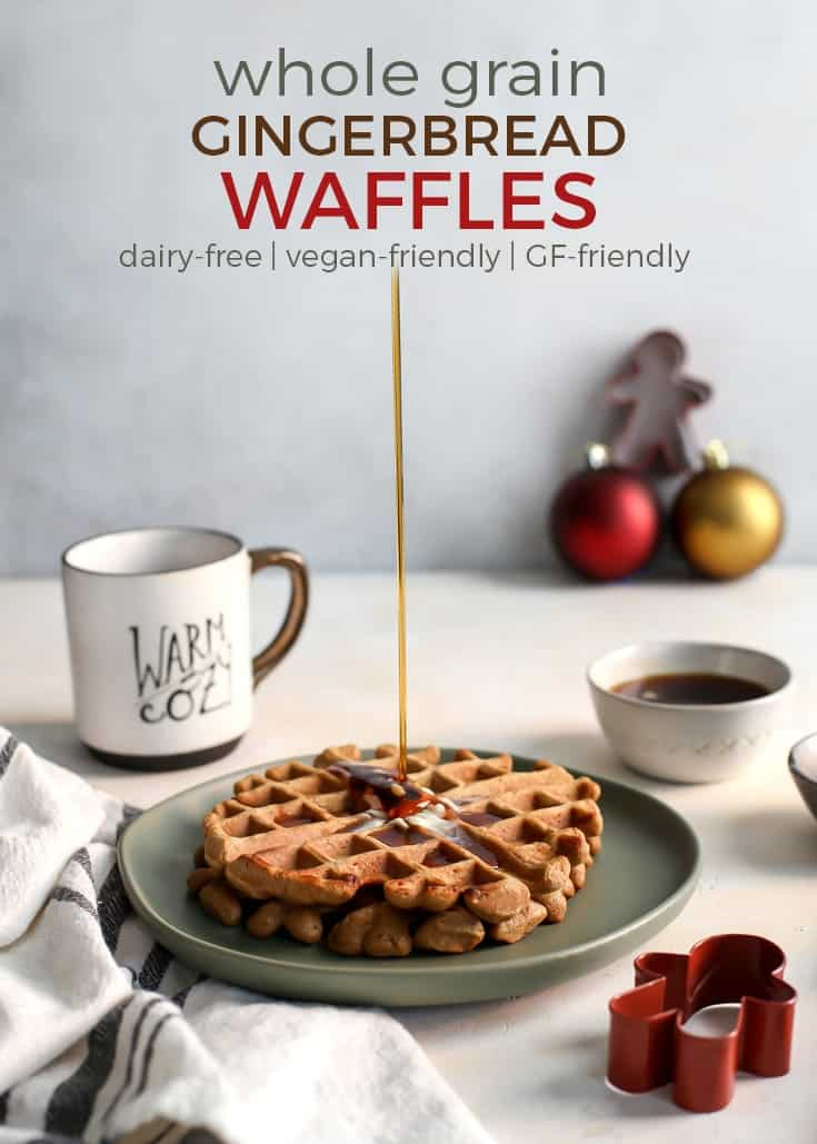 whole grain gingerbread waffles and syrup on green plate with coffee cup and christmas decor