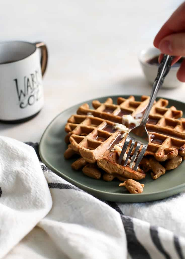 gingerbread waffles eaten with fork on green plate