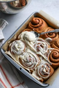 Easy Whole Wheat Gingerbread Cinnamon Rolls with delicious Greek yogurt cream cheese frosting. Add maple extract to the frosting for a delicious flavor boost.