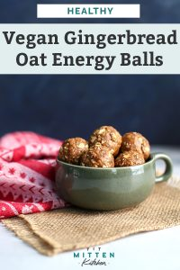 healthy gingerbread oat energy balls in large green mug sitting on counter