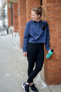 Nike Dri-FIT training crewneck crop sweatshirt and high waisted leggings with water bottle