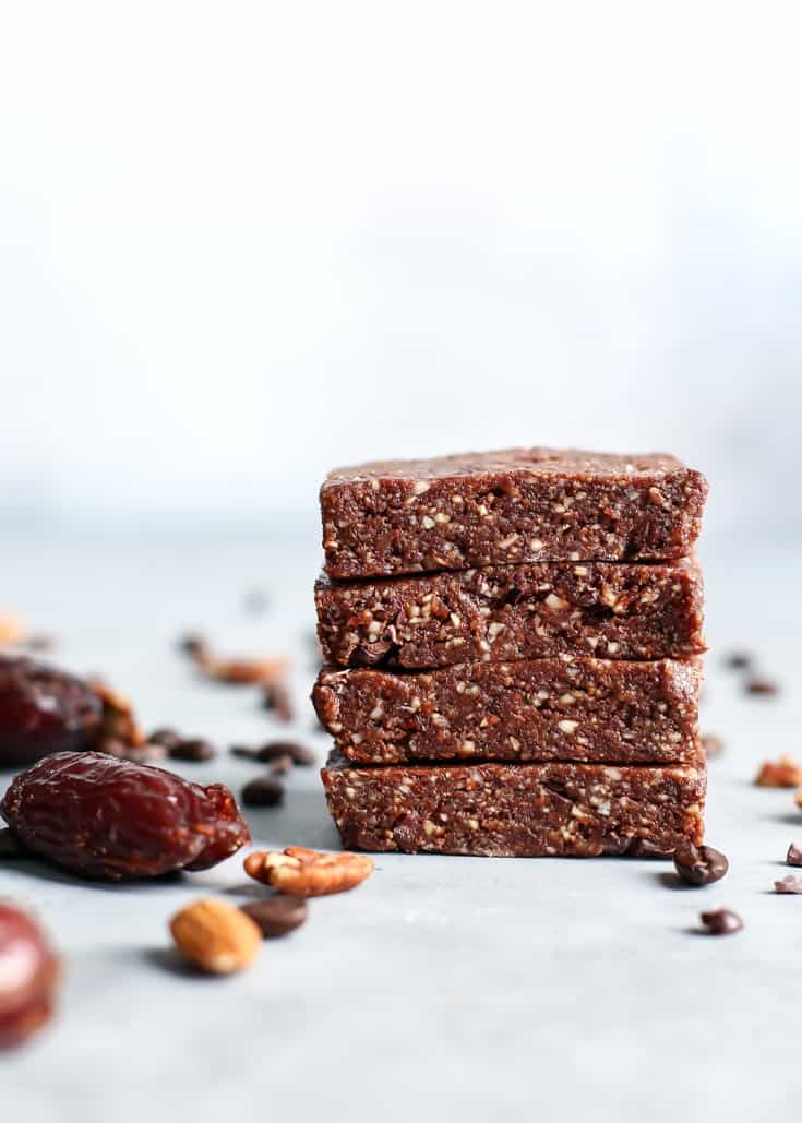 stacked bars, protein bars, medjool dates, almonds, pecans, coffee beans