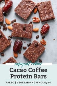 paleo cacao coffee protein bars cut up and sitting on counter with dates, nuts and coffee beans