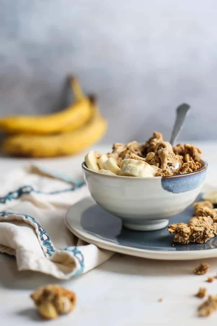 bowl of yogurt with banana granola, cashew butter and bananas