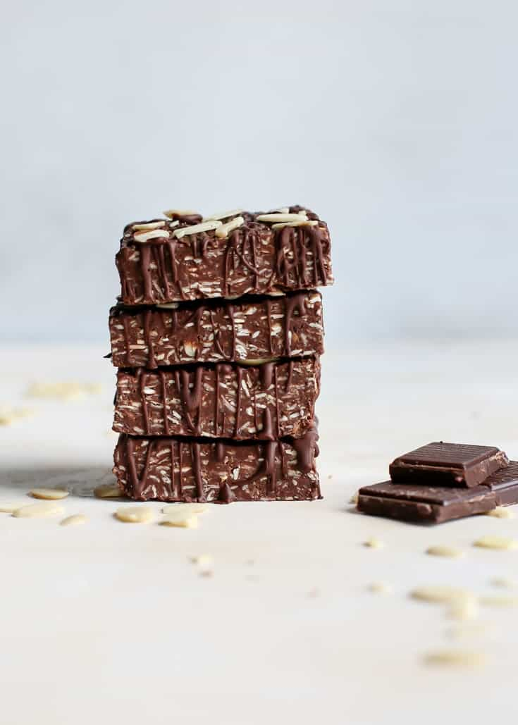 stack of chocolate almond butter protein bars with oats, almond slivers and dark chocolate pieces