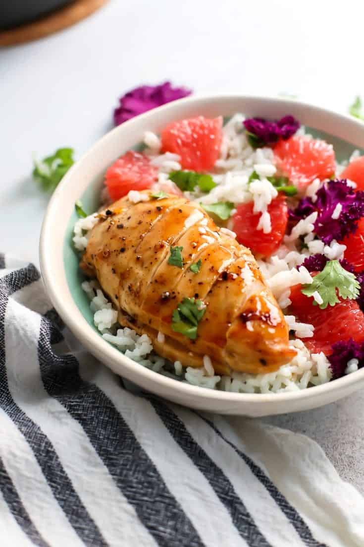 glazed chicken breast with grapefruit, rice, kale and mint in a bowl.