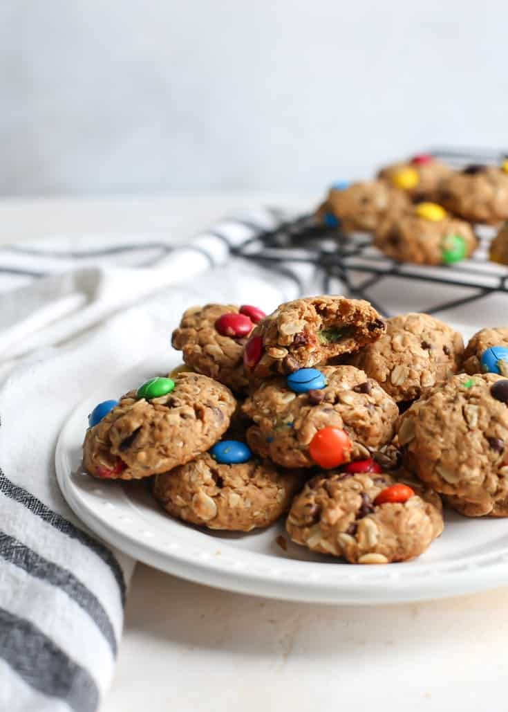 monster cookies on plate with cooling rack