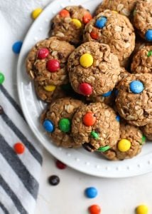 close up healthy peanut butter monster cookies with m&ms with kitchen towel